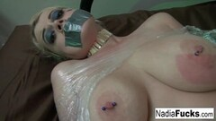 Naughty Nadia White is wrapped in plastic and groped Thumb