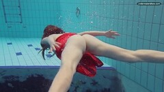 Wet Red Dressed teen swimming with her eyes opened Thumb