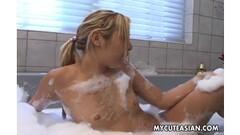 Asian teen has a hotl bath Thumb