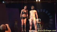 Extreme fetish fucking on public stage Thumb