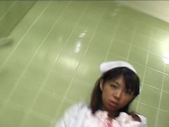 Pissing Asian nurse Thumb