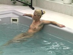 Blonde girl pleases herself after a swim Thumb