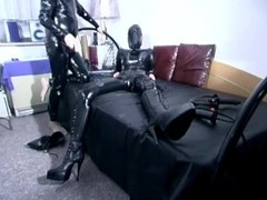 Latex sub teased with spanking Thumb