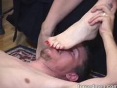 Naked man licks and worships his tired mistress' feet Thumb