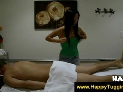 Asian masseuse examines her clients body Thumb