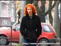 Mature redhead taking a piss in a public park Thumb
