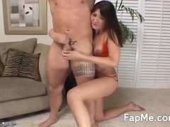 Naughty girl in red bikini stroking a huge wet cock on the couch Thumb