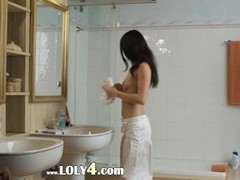 Brunette girl strip in the bathroom Thumb