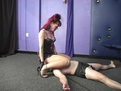 Domme using chastity slave Thumb